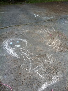 K's daughter's precious drawings on the driveway. The House provides stability for her while her mom gets things back in order.