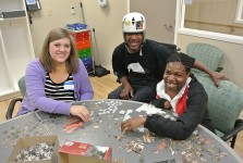 Chris, LaQuita, and I working on a puzzle.