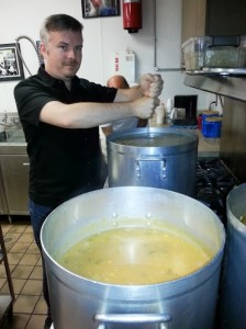 Michael Garcia keeps the soup from sticking at St. Mary's Soup Kitchen.