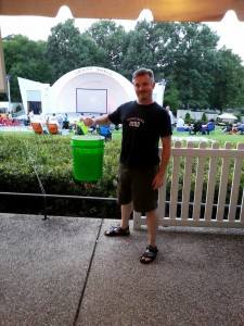 Michael Garcia with the donation bucket for Indie Memphis at the Levitt Shell.