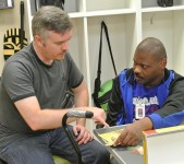 Michael helps Earnest with a puzzle at the SRVS Learning Center.