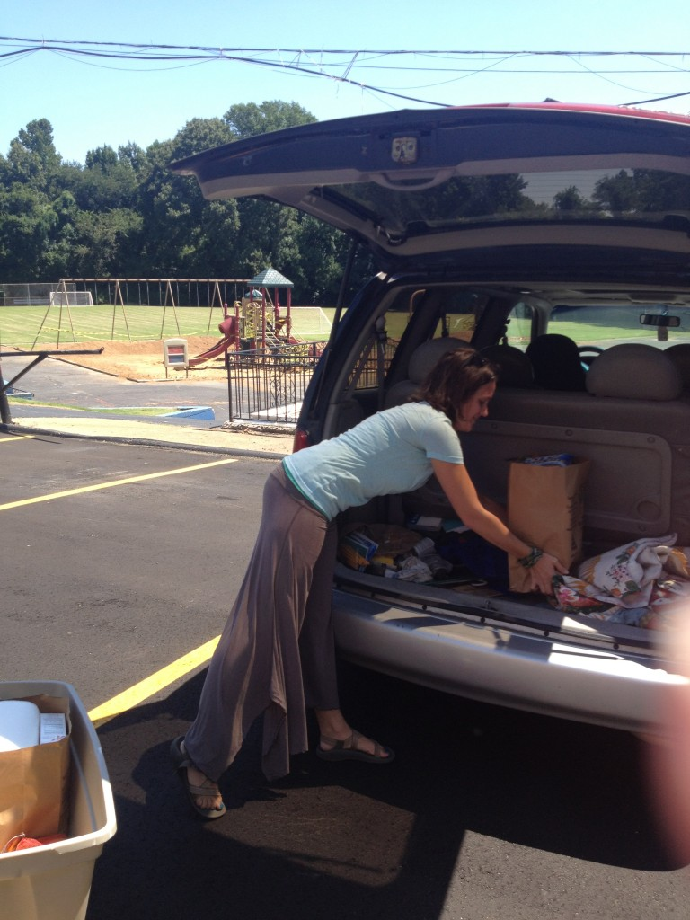 Loading groceries for a family with Catholic Charities Mobile Food Pantry