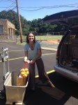 Loading a family's portion of fruit with Catholic Charities Mobile Food Pantry