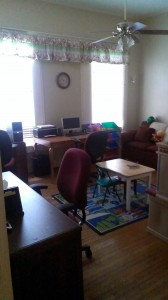 The office/play room downstairs. This space allows the family to search for jobs online while letting their little ones play.