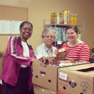 Packing up a box a the Fig Tree Food Pantry with the help of Ms. Gloria and Ms. Mary - so much fun!