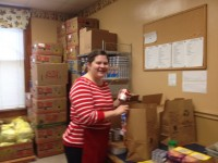 Behind the scenes packaging food parcels at the Catholic Charities of West Tennessee Fig Tree Food Pantry