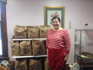 Standing up front preparing to hand out food parcels at the Fig Tree Food Pantry (with a smile!)