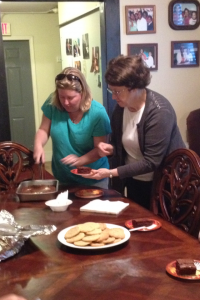 Sister Maureen and another volunteer cut in to a dessert to share.
