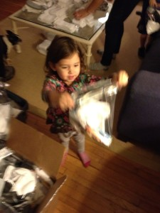 Ella helps assemble survival kits