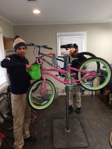 Two almost-graduates of the CAG bike mechanics program
